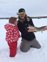Little Girl with Caught Fish at Snowy Lake Wabamun